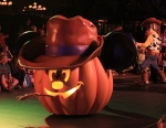 A Farmer Mickey jack o' lantern float, plus one of the Woodys of Disneyland in the background.